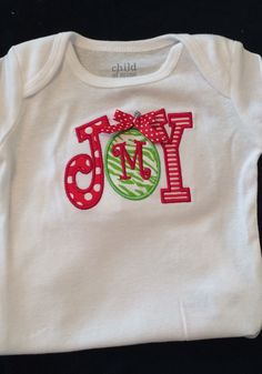 Baby Girl Christmas Monogrammed and Appliqued JOY  with initial Ornament Bodysuit for Baby Girl or Boy  0-18 months or a T-shirt 12, 18, 24. by PurttyStitches on Etsy https://www.etsy.com/listing/209232040/baby-girl-christmas-monogrammed-and