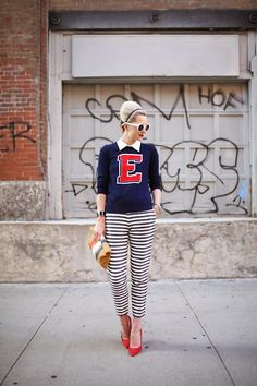 varsity sweater with striped pants