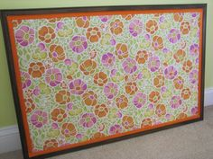 fabric-covered cork board - for the toddler's growing collection of art