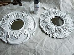 Use ceiling medallions and put mirrors in middle, paint to match your theme, paint with flat and glossy of the same color to have a chic look or add that glue with glitter so it dries clear but the glitter gleams:)