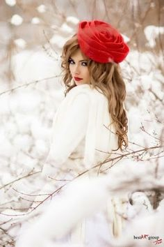 Pretty in the snow.  Looks like a big ROSE on her head.