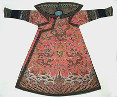 Woman's Robe of State Period: Qing dynasty (1644–1911) Date: 18th century Culture: China Medium: Silk and metallic thread embroidery on silk satin weave patterned with extra continuous wefts Accession Number: 35.84.4