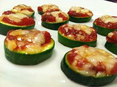 ...They're little zucchini pizzas o:   Go visit this girl's website, I've already bookmarked 10 recipes that I want to try out!