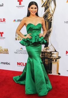 Melissa barrera wears an emerald peplum dress to the alma awards