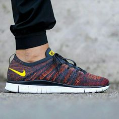 #copordrop?: @nike Free Flyknit NSW Anthracite/Laser Orange/Gym Red. Photo: @titoloshop