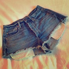 American Eagle High waisted shorts American Eagle denim jean shorts. Three buttons for a great high waisted look. Frayed bottom and exposed pockets. American Eagle Outfitters Jeans