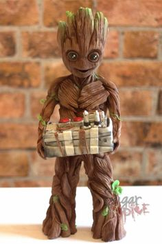 VIDEO: Basingstoke cake maker wows Guardians of the Galaxy director with chocolate sculpture (From Daily Echo) (Galaxy Food Videos) Baby Groot Cake, Cupcakes, Cupcake Cakes, Galaxy Desserts, Galaxy Cake, Chocolate Sculptures, Crazy Cakes, Fancy Cakes, Chocolate Art