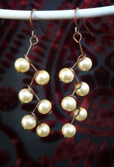 Ivory pearl cascade earrings by StormwolfStudios on Etsy