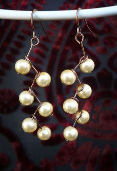Ivory pearl cascade earrings by StormwolfStudios on Etsy, $12.00