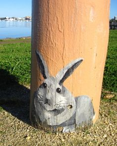 Geelong, Victoria, Australia - An icon of Geelong, 100 bollards line the waterfront from Rippleside to Limeburners Point. Jan Mitchell sculptured the bollards out of huge old wooden pylons and hand-painted them to depict people and events of Geelong. There is a rabbit on each one somewhere as her signature.