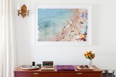 A styled console table with a beach photograph