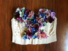 DIY - BEJEWELED FLORAL BUSTIER Incredibly inspired by Katy Perry's Victoria Secret runway look, I decided to re-create it for this summer's EDC Music Festival. I had a blast making this gorgeous...