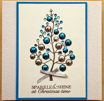 Woodware Christmas tree stamp, finished with craftwork candi, sparkles and a bow