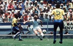 Keep ball: Moore keeps the ball away from Pele during England's defeat to Brazil in the 1970 World Cup in Mexico