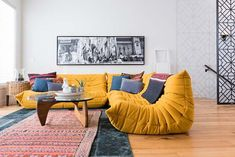 Modern urban infill in Calgary showcasing reclaimed materials feat. the sofa System Togo by Ligne Roset