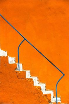 color orange and white stairs blue railing