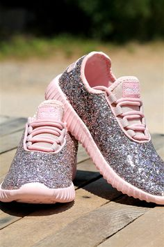 "Our gorgeous Glitter Bomb Sneakers make the perfect statement for that cute new workout outfit you just got! They have a pink bottom and a label on the tongue that says ""Southern Fried Chics"". They have two strips of label on the back of the heel that form a cross that matches the label on the tongue."