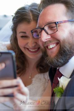 This fabulous couple totally embraced social media and technology during their wedding.  During the signing of the register photos they took a selfie. So I took this photo of them taking their photo.
