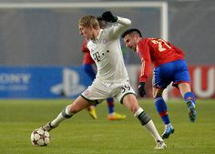 Zoran Tosic (R) of PFC CSKA Moscow in action against Toni Kroos of FC Bayern Muenchen during the UEFA Champions League Group D match between PFC CSKA Moscow and FC Bayern Muenchen at the Arena Khimki Stadium on November 27, 2013 in Khimki, Russia.