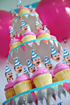 Maybe its just the angle of the shot, but a kid head on a stick in my cupcake?  Creepy if you ask me....