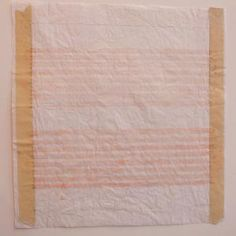 """Agnes Martin, C. 1990's, paper size 11 x 11 inches, watercolor and graphite on paper.  A preliminary study made with watercolor and graphite on paper. This study is for the larger acrylic on canvas painting titled """"I LOVE THE WHOLE WORLD"""" created in 1999. As the image shows, the masking tape which has the original measurement markings remain on this piece. The masking tape is inscribed """"top"""" on both right and left sides."""