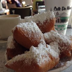 A must visit (either breakfast or late night). Delicious beignets, or fried donuts covered with powdered sugar, and café latte. A New Orleans institution. [TM- i absolutely LOVE Cafe du Monde's beignets! Visit New Orleans, New Orleans Travel, Fried Donuts, Good Food, Yummy Food, Down South, Places To Eat, So Little Time, Powdered Sugar