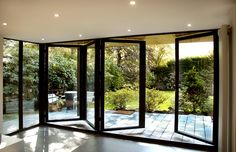 These are black leather folding glass doors, good in a metal or water direction (W, NW or N), but should also be at the back of the house since they are so open. Too much glass can make one feel vulnerable, like a goldfish in a bowl.