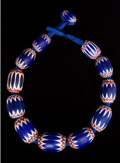 """Chavron trade beads from Africa. Rare, century, Chevron beads It is claimed that Maria Barovier """"invented"""" the Rosetta bead in the late fifteenth century. It was later called a chevron bead by. African Accessories, African Jewelry, Tribal Jewelry, Beaded Jewelry, Beaded Necklace, Beaded Bracelets, Gold Jewelry, Jewelry Necklaces, Chevron Necklace"""