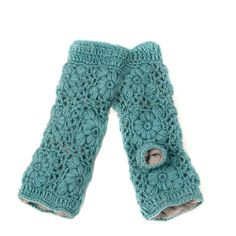 Nirvanna Designs' Flower Crochet Handwarmers add a touch of whimsy to your garb, reminding you of gardens wherever you go, leaving your fingers free to flit around, take photos, and touch the world as