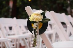 Aisle markers with vinyl records for rock n' roll wedding. #recordwedding