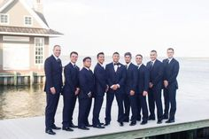 Groom and groomsmen on the water at Mallard Island Yacht Club