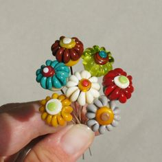 Handmade lampwork glass flower headpins in autumn colors by Flamejewels. $15.00, via Etsy.