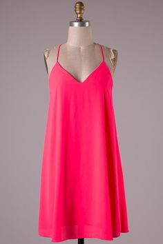 Neon Pink Racer Back Dress. This would be perfect with a really bold necklace or group of necklaces.