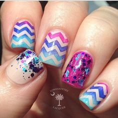 Ombre Chevron from light purple to light blue. Accent nails have similar colors of glitter chunks