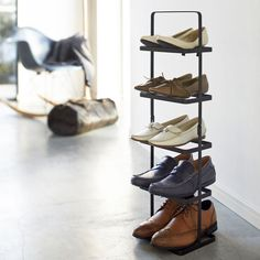 The Yamazaki Tower Shoe Rack in black is just a great way to keep your most used shoes together and to hand. With 5 levels it makes it perfect for the whole family, keeping those outdoor shoes close to the door or those indoor slippers in a place you know rather than all over the house! Its also portable, its simple carry handle allowing you to easily carry it from room to room, wherever you want it to be at the time.With its sturdy metal construction it is designed to freely stand anywhere you  Shoe Rack Tall, Slim Shoe Rack, 5 Tier Shoe Rack, Shoe Racks, Minimalist Shoes, Minimalist Decor, Minimalist Wardrobe, Japan Design, Vertical Shoe Rack