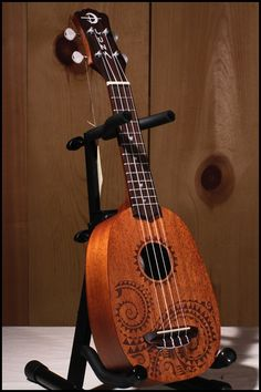 "I have a feeling you'll be coming home to me very soon.    (Luna ""Tattoo"" Pineapple soprano ukulele)"