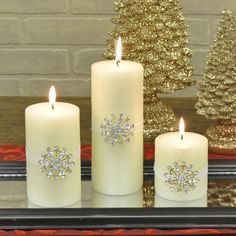 """This is a must have candle for the winter season.  The candle has a soft textured linen finish with a jeweled snowflake that captures the light, and sparkles and shines, creating an ambiance of freshly fallen snow on a clean, crisp winter day when everything is quiet and peaceful.  Use in combination with the other jeweled candles or with holiday greens to create your own winter scene.  Unscented. Candles sold separately, Short candle measures 3"""" x 3"""". #winter #decor #candle #snowflake"""