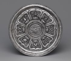 Dish with Eight Buddhist Treasures, Yuan dynasty (1271–1368), 14th century, China. Silver.