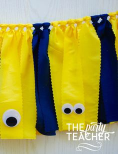 Fun yellow and navy fabric tie garland, complete with wiggly eyes -- just like the Minions in their overalls. The perfect touch for your Minions Party. Just add my Minions bunting to your party, and m