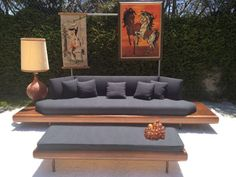 This is the most amazing mid century modern sofa set that I have ever seen. It is made by famous furniture designer Adrian Pearsall. The set includes the sofa and matching coffee table that doubles as an ottoman. The sofa has a walnut platform base that acts like attached end table.