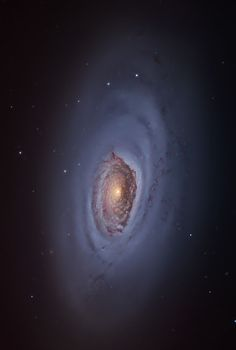 "#M64 from #Grantecan | M64 is a spiral galaxy known as the Galaxy ""Black Eye"" because of a spectacular dark band of absorbing dust in front of the nucleus, resulting in a dark appearance. With an apparent magnitude of 8.8, you can glimpse with binoculars on dark nights, appearing as an irregular region of diffuse light."