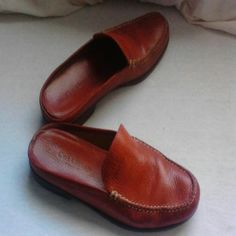Red Cole Haan leather slip on or mule shoes 7.5 B Beautiful red Cole Haan shoes where shows on Soul Sand back of heel you may be able to reglue liner on end of heel basically just a decent pair of shoes please refer to photos for condition if you need additional close-ups let me know happy to take offers as these are just a smidgen too tight for my feet. Color more true red than foto shows.   This is a popular item on posh in red and in black. Cole Haan Shoes Mules & Clogs