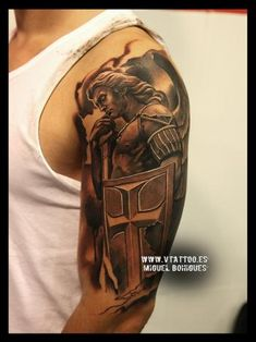 Tatuaje estatua San Miguel Arcángel - Miguel Bohigues