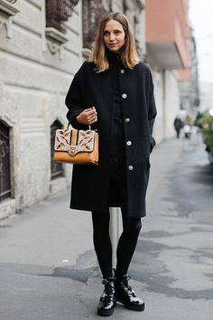 Wear your coziest navy and black pieces from head to toe but add some excitement with an out-there handbag, statement necklace, or bright lip color.