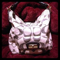 MAKE AN OFFER!!! Authentic Coach slouch purse. Make me a REASONABLE offer! Cream with brown C's purse. Perfect condition. Only worn a few times. Coach Bags