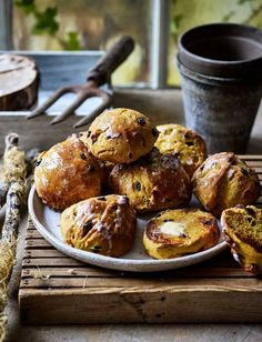 A Cornish classic, these golden fruited buns were traditionally a treat for children at church functions. Their golden colour and flavour comes from saffron, which was once grown in the county Saffron Buns Recipe, Bun Cake, British Baking, Bun Recipe, Sainsburys, Food Trends, Cookies Ingredients, Food Inspiration, Sweet Recipes
