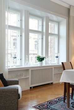 dustjacket attic: A Stockholm Apartment Good Rad cover treatment Bay Window Living Room, Stockholm Apartment, Radiator Cover, Radiators, Interior Inspiration, Living Spaces, Sweet Home, New Homes, Room Decor