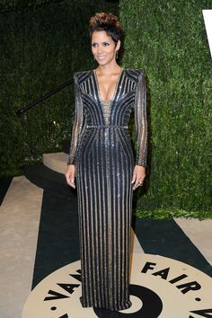 Academy Award Winner Halle Berry chose to wear the same look she wore earlier that evening to the 2013 Oscars - she was absolutely perfect in a custom-made black longsleeve gown with plunging neckline, covered entirely in ombre stripes composed of mesh beading.