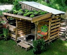 A dog house with a green roof porch. I think I'd have to make the other roof green, too.