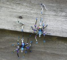 Beaded spider earrings made with crystals and seed beads. Earrings measure about 3 from top of hook to bottom of foot. Wire Wrapped Jewelry, Wire Jewelry, Beaded Jewelry, Jewellery, Halloween Earrings, Halloween Jewelry, Beaded Rings, Beaded Bracelets, Glass Bead Crafts